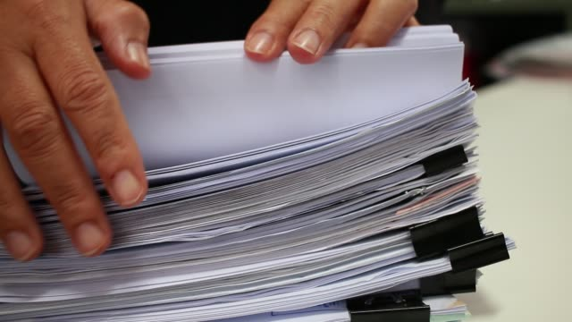 Businessman hands searching unfinished documents stacks of paper files on office desk for report papers, piles of papers sheet achieves with clips on desks, Document is written, drawn,presented. Businessman hands searching unfinished documents stacks of paper files on office desk for report papers, piles of papers sheet achieves with clips on desks, Document is written, drawn,presented law stock videos & royalty-free footage