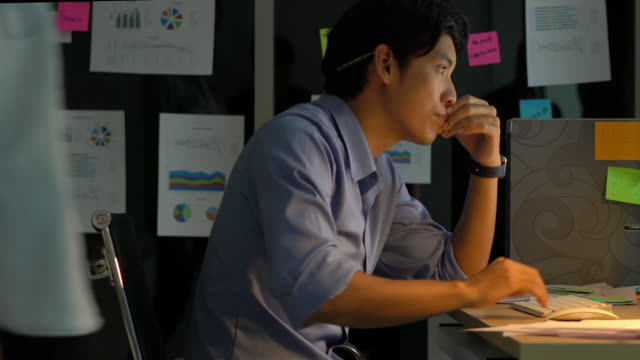 Businessman hard working with desktop computer to late night at office. Business people work overtime. Concept of salary man, fatigue and tired. Businessman hard working with desktop computer to late night at office. Business people work overtime. Concept of salary man, fatigue and tired. overworked stock videos & royalty-free footage
