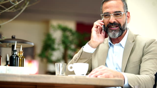businessman having a personal phone call - uomini maturi video stock e b–roll