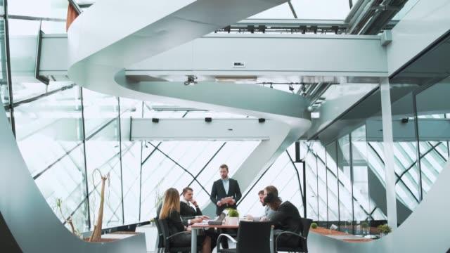 businessman having a presentation during a meeting - modern office filmów i materiałów b-roll