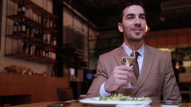 Businessman having dinner in restaurant