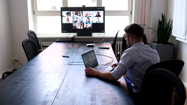 businessman having online briefing with team - new normal video stock e b–roll
