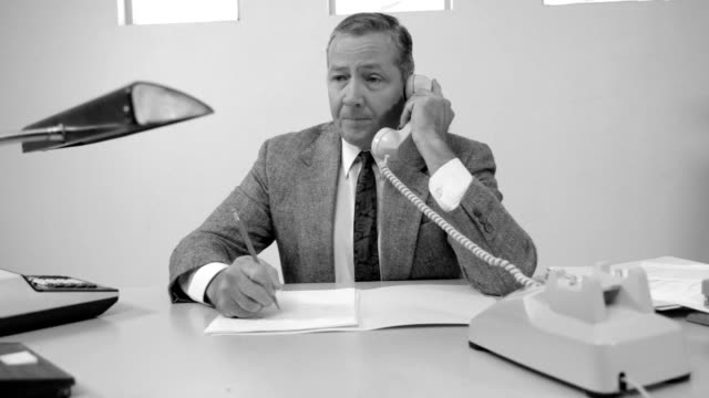 Businessman having trouble with telephone