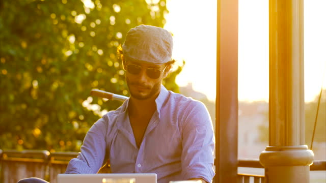 Businessman hipster in cafe on laptop video