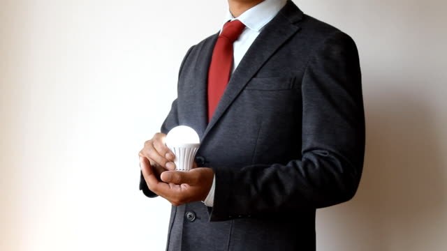 Businessman holding bulb light video