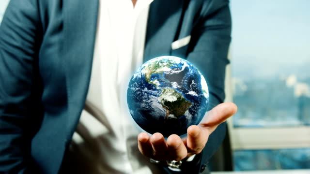Businessman Holding Globe video