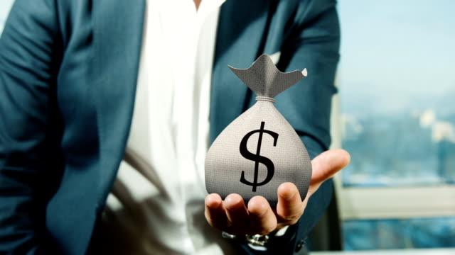 Businessman Holding Money Bag video
