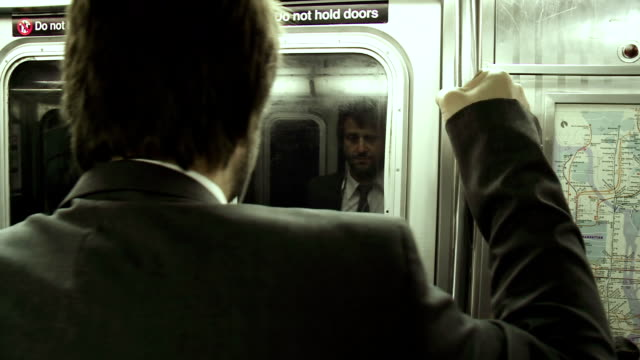 HD: Businessman Holding On To The Subway Pole video