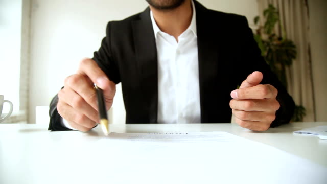 Businessman holding pen pointing on contract, offering to sign document video