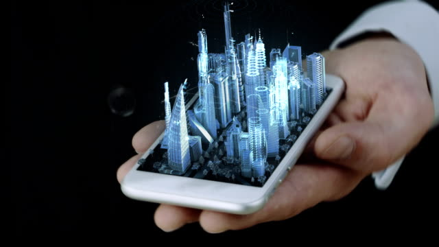 Businessman holding phone with 3D city hologram video