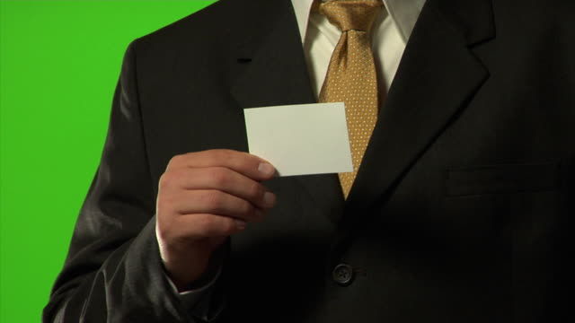businessman holding up a card - business card stock videos & royalty-free footage