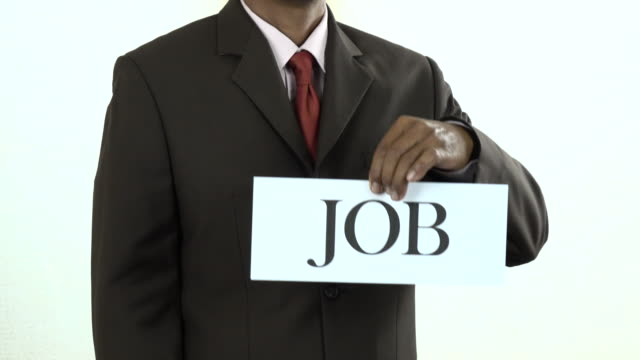 Businessman holding white card with Job sign