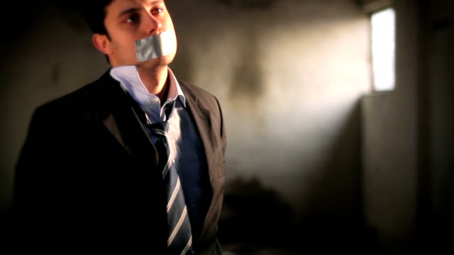 Businessman Hostage Tape over Mouth Tied Up Scared video