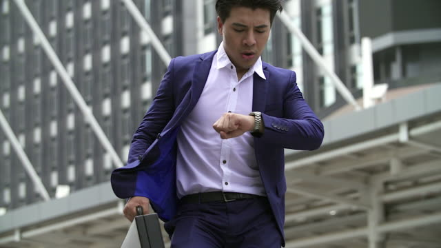 Businessman in a hurry running, he is late for his business appointment.Focusing on his briefcase.case. video