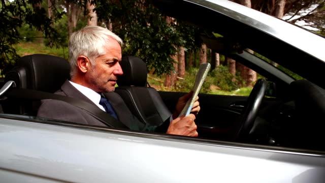 Businessman in a silver  car