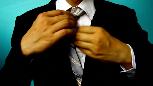 businessman in black costume tie one's necktie video