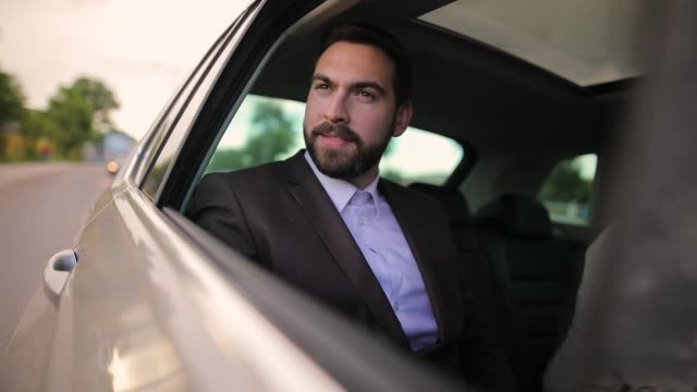Businessman in car looking through the window video