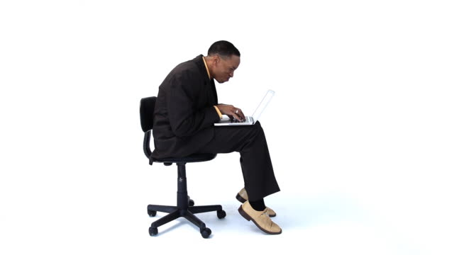 Businessman in chair with laptop computer video