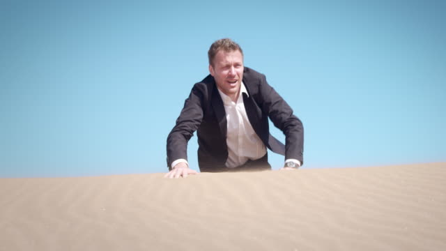 Businessman in desert Selected Takes - Shot on RED Epic lost stock videos & royalty-free footage