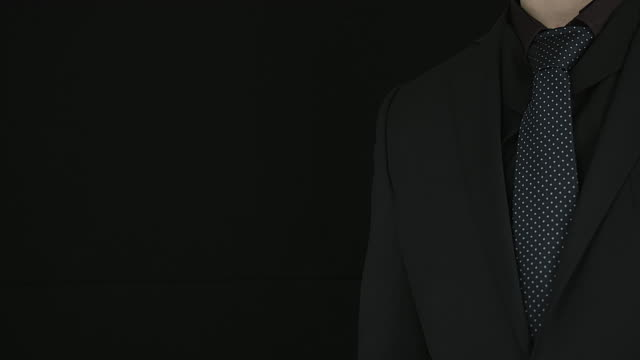 Businessman In Suit Performing Clicks On A Black Background. video