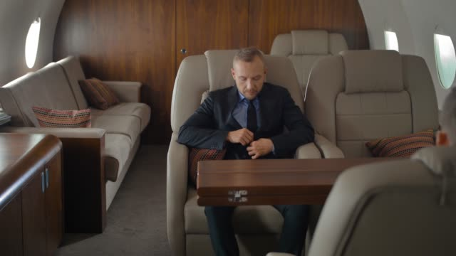 Businessman inside of private jet luxury interior video