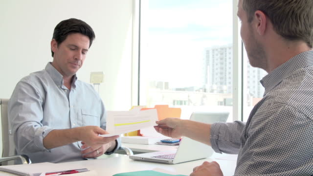 Businessman Interviewing Candidate For Job In Design Agency video