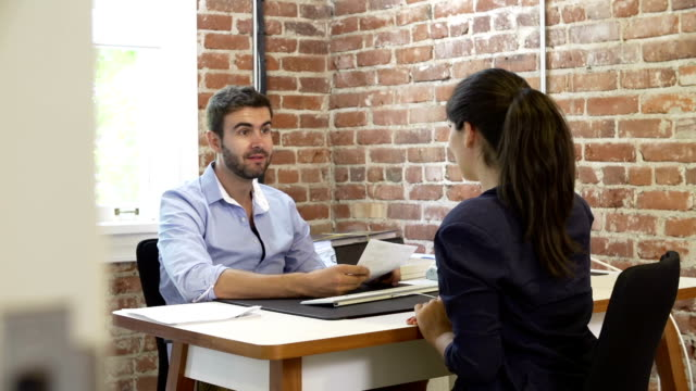 Businessman Interviewing Female Job Applicant In Office video