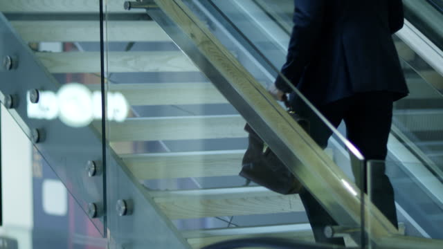 Businessman is Climbing the Stairs video