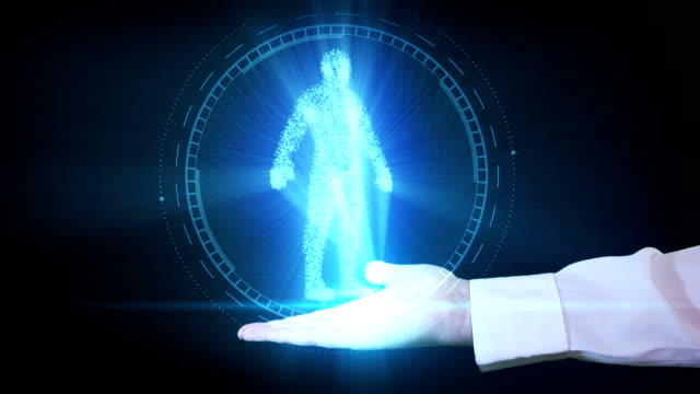 Businessman is holding a human hologram in his hand video