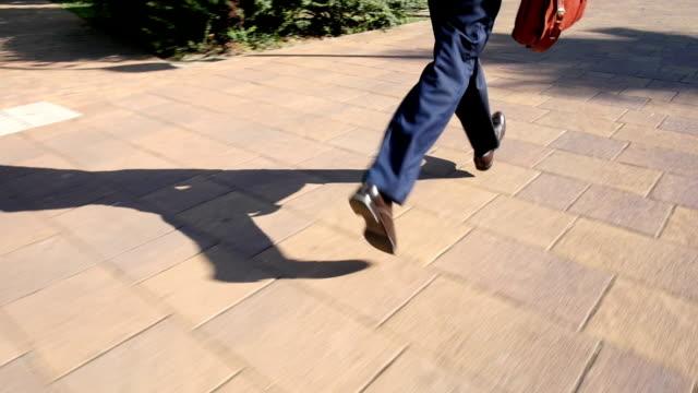 Businessman is runs on a city street video