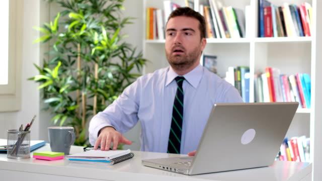 Businessman is sleeping on the office desk video