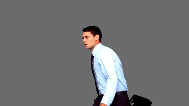 stockvideo's en b-roll-footage met businessman jumping on grey screen - overhemd en stropdas