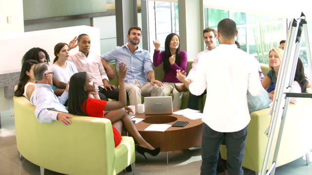 Businessman Leading Brainstorming Session With Colleagues video