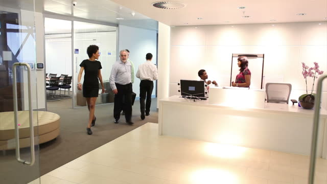 Businessman leaves office following meeting video
