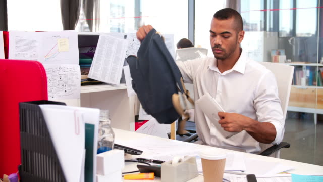 Businessman Leaving Office At End Of Working Day video