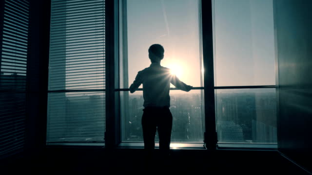 Businessman look forward to the future Businessman looking out of the window in office sunrise dawn stock videos & royalty-free footage