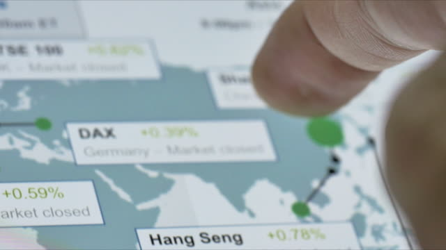 Businessman looking at Stock Market around the world,Close-up video