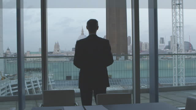 Businessman Looking Out Over London City video