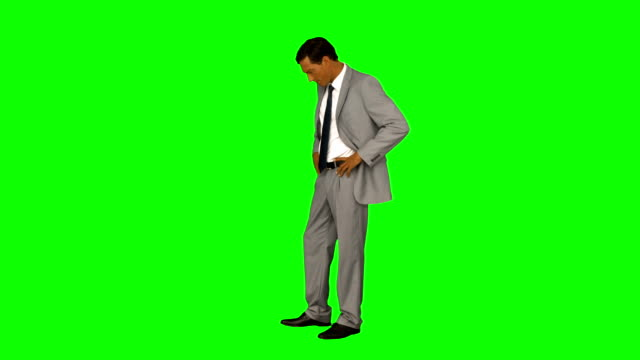 Businessman looking something with hands on hips Businessman looking something with hands on hips on green screen background arms akimbo stock videos & royalty-free footage