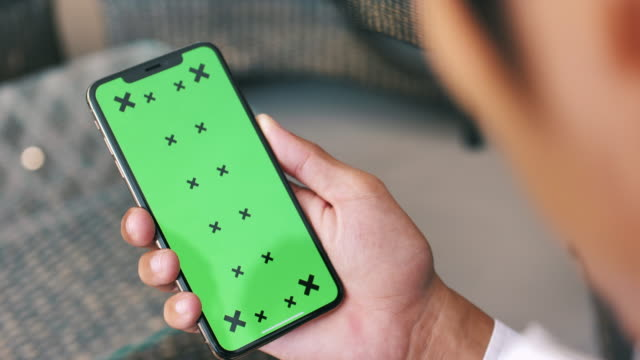 Businessman looks at smartphone green screen Chroma Key,Smart Phone,Men Businessman looks at smartphone green screen chroma key stock videos & royalty-free footage