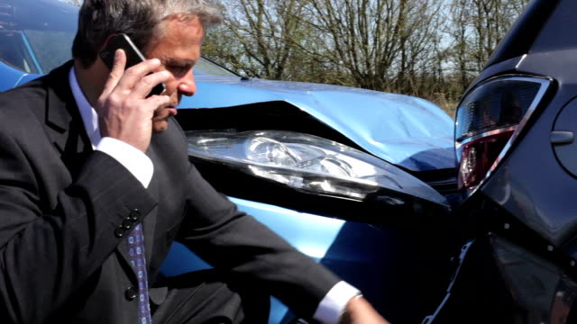 Businessman Making Phone Call After Traffic Accident video