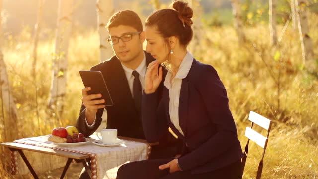 Businessman making proposition tablet teamowork video