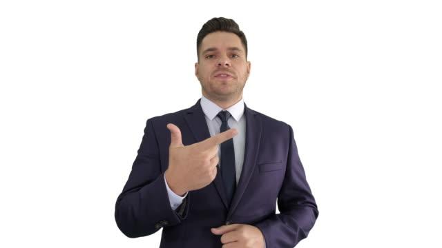 白い背景に短いビジネスのヒントトレーニングを与えるビジネスマンマネージャー - プロジェクトマネージャー点の映像素材/bロール