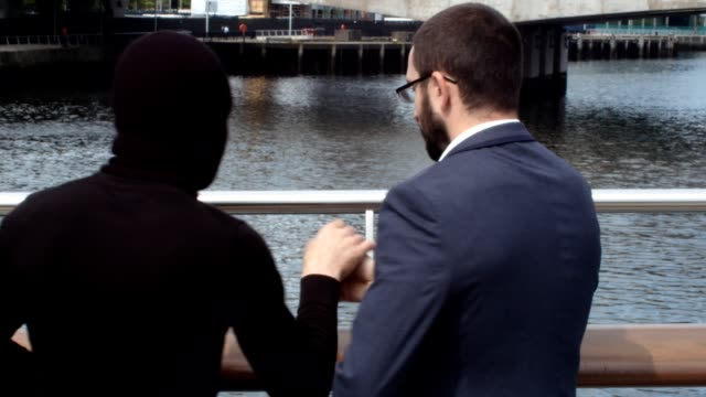 Businessman Meeting A Criminal To Secretly Take A Suitcase. video