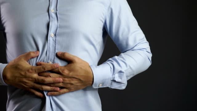 Businessman on blue shirt feel stomachache
