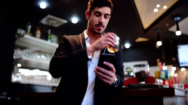 Businessman on break in the bar video