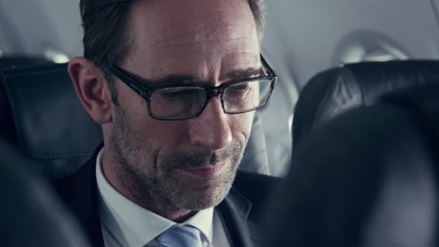 Businessman on plane video