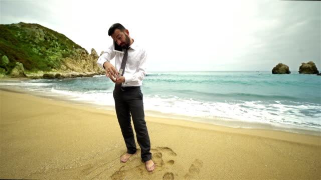 Businessman on the Beach - 4K Resolution video