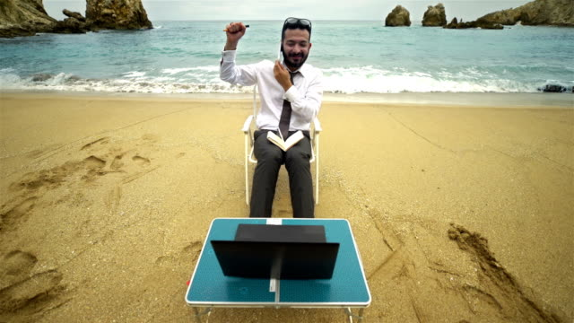 Businessman on the Beach - 4K Resolution video