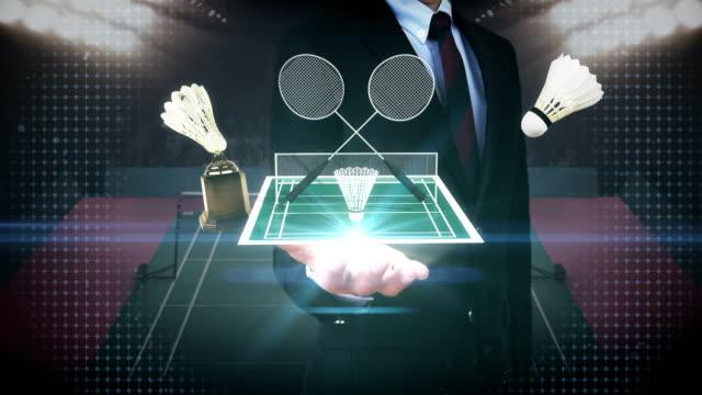 ビジネスマンは、パーム、バドミントン アイコン、羽根、ネット、バドミントンの競技場を開きます。 - スポーツ バドミントン点の映像素材/bロール